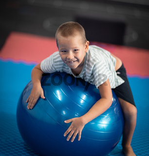 boy doing exercises with ball