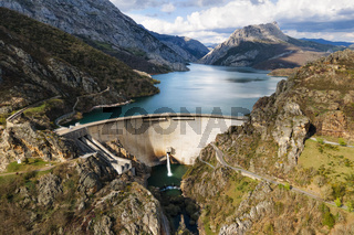 Aerial view of Water dam and reservoir lake, generating hydro electricity power renewable energy and sustainable development. High quality photo