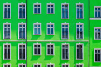 renovated apartment house with green facade, residential building exterior