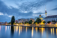 The river Spree in downtown Berlin with the famous TV Tower at dusk