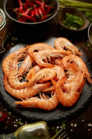 Fresh and raw big shrimps ready to be prepared. With various ingredients on side