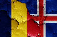 flags of Romania and Iceland painted on cracked wall
