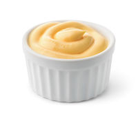Ceramic  dipping cup of cheese sauce