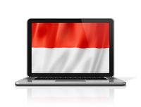Monaco flag on laptop screen isolated on white. 3D illustration