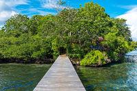 Pier and wooden boardwalks in the Araya resort on the Togian Island Batudaka