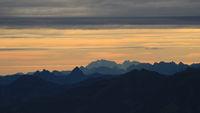 Bright lit yellow morning sky over Mount Grosser Mythen.