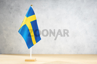 Sweden table flag on white textured wall. Copy space for text, designs or drawings
