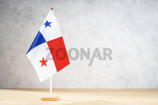Panama table flag on white textured wall. Copy space for text, designs or drawings