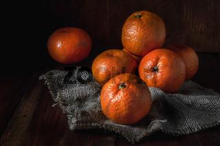 tangerines in bulk on a coarse fabric
