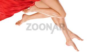 Two pairs Long pretty woman legs
