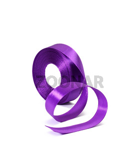 rolled purple silk ribbon in roll isolated on white background