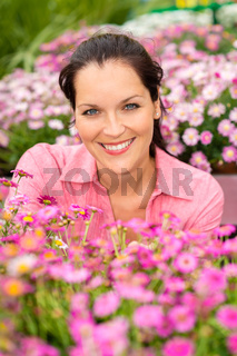 Portrait beautiful woman with purple daisy flowers