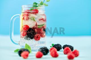 Fresh berries cocktail in glass jar