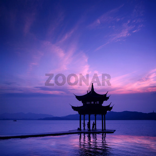 ancient pavilion on the west lake with sunset