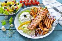Greek grill platter with farmer's salad