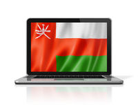 Oman flag on laptop screen isolated on white. 3D illustration