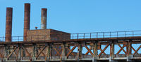 Old coal-fired power station with blue sky.