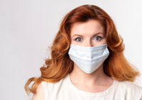 Middle age woman wearing coronavirus protection mask