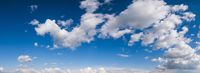 White clouds in blue summer sky panoramic  background