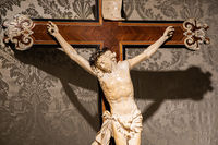 Old crucifix made of wood and ivory. Jesus Christ symbol of resurrection and life after the death.