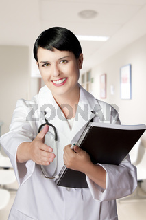 brunette female doctor on duty welcoming patient at the hospital
