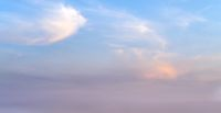 Picturesque evening sunset sky background with clouds