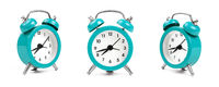 Three teal blue alarm clock over white