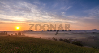 Val d'Orcia after sunset with photographer, Tuscany, Italy