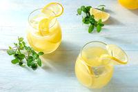 Lemon ice tea. Homemade fresh lemonade on a wooden background