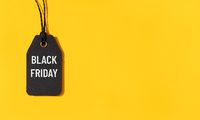 Black friday tag isolated on yellow background with copy space