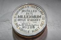 Millennium Irish whiskey sign in Old Bushmills Distillery on wooden barrel