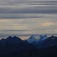 Clouds over Mount Titlis and other mountains of the Swiss Alps.
