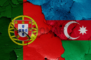 flags of Portugal and Azerbaijan painted on cracked wall