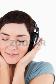 Portrait of a delighted woman enjoying some music
