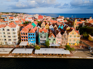 Willemstad, Curacao. Dutch Antilles. Colourful Buildings attracting tourists from all over the world. Blue sky sunny day Curacao