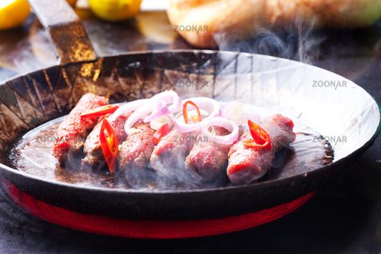 Cevapcici in the pan