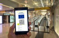 Woman showing on smartphone EU Digital Covid Certificate.