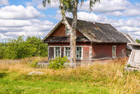 Old rural wooden houses in abandoned russian village