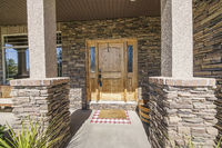 Entrance exterior of a house with stone veneer siding