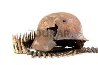 The rusty raked helmet and machine-gun tape