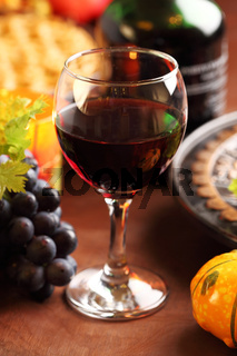 Glass of red wine and grapes for Thanksgiving
