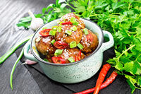 Meatballs in sweet and sour sauce on board