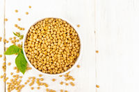 Soybeans in bowl with leaf on board top