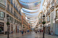 Shops in a shopping street in downtown Malaga (Calle Marques de Larios).