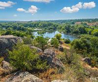 Summer Pivdennyi Buh (Southern Bug) river in Myhiya, Mykolayiv Region, Ukraine. Landscape of the river with rocky coast.