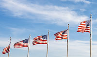 A group of American flags waving