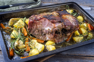 Traditional corned pot pork roast offered with potatoes