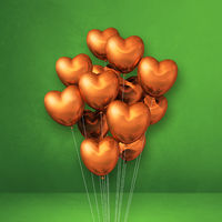 Copper heart shape balloons bunch on a green wall background