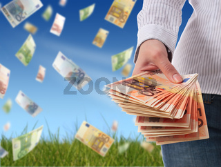 Financial concept. Woman giving money over sky background.