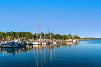 Lauterbach harbour on Ruegen island in evening sunlight